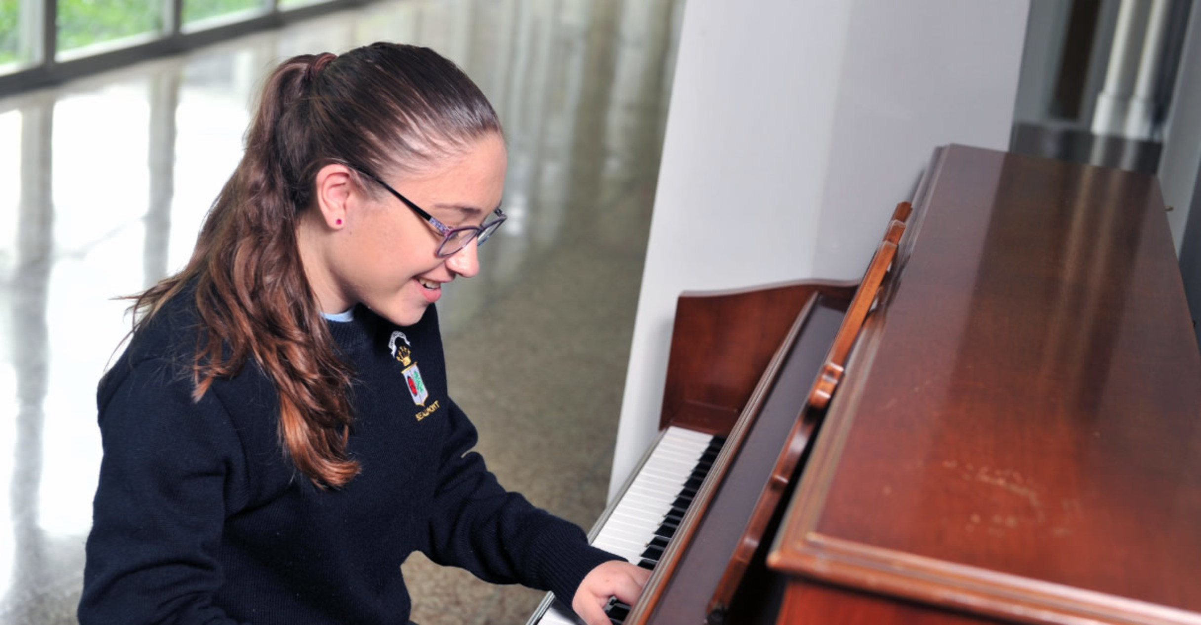Beaumont school student playing piano